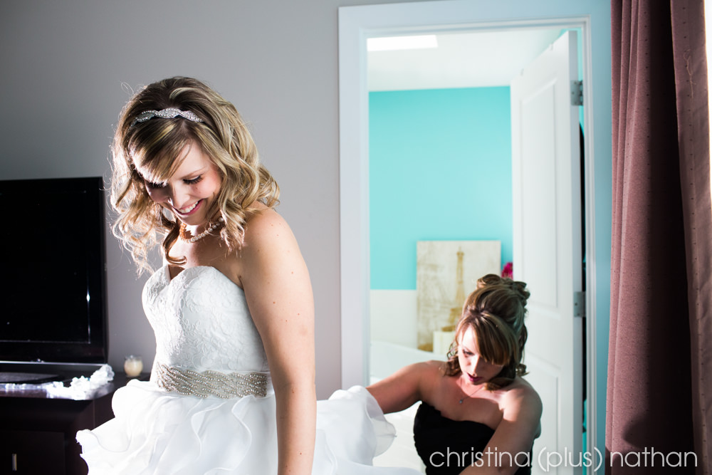 Bride getting dress on