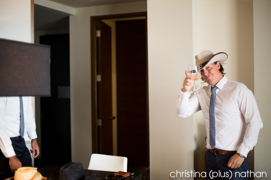 Groomsman with cowboy hat in Calgary wedding photos