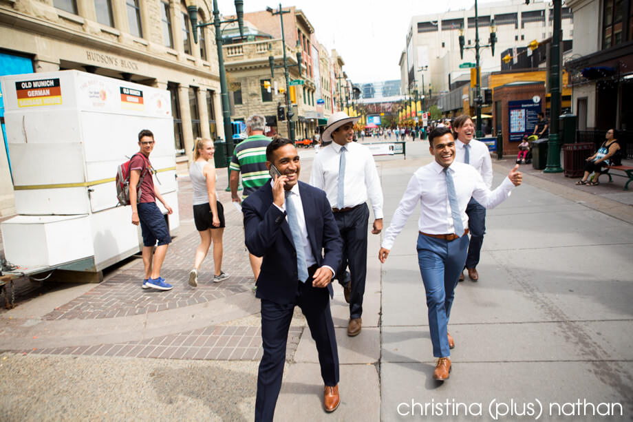 Groom walking down Stephen Avenue in Calgary