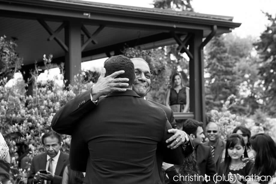 Dad hugging groom