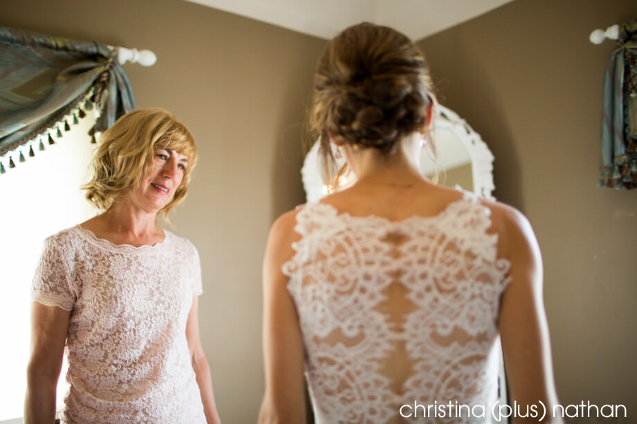 Mother of the bride looking at her daughter, getting ready for Bow Valley Ranche Restaurant wedding