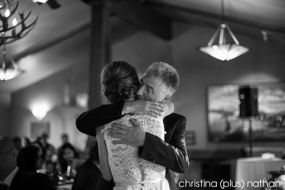 Father hugs bride during wedding speech at Bow Valley Ranche Restaurant