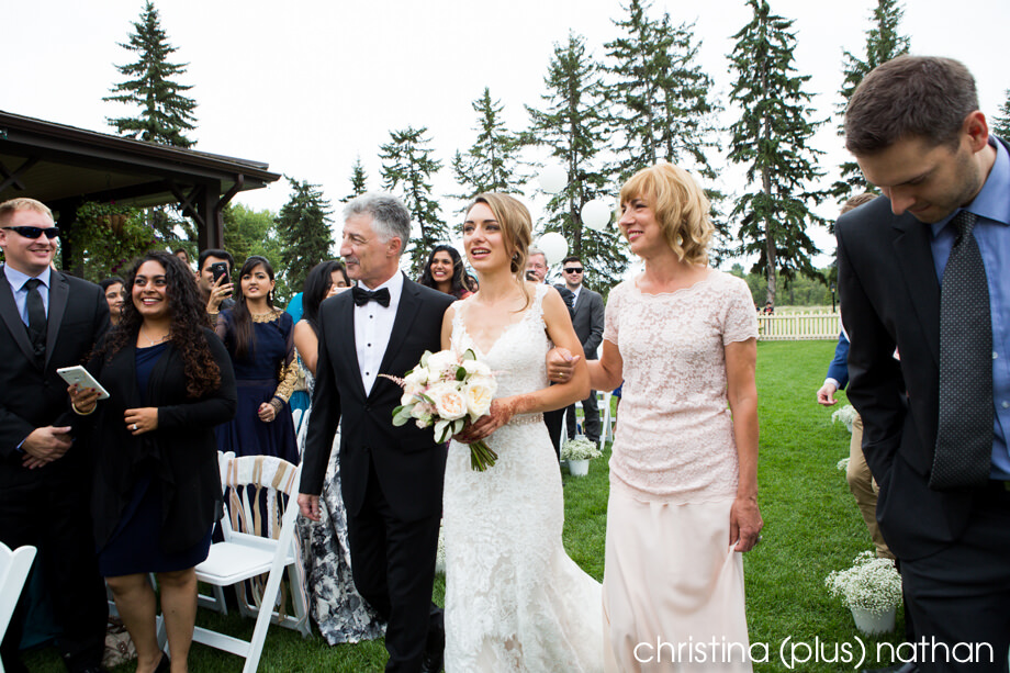 Bride walking down aisle at Bow Valley Ranche Wedding