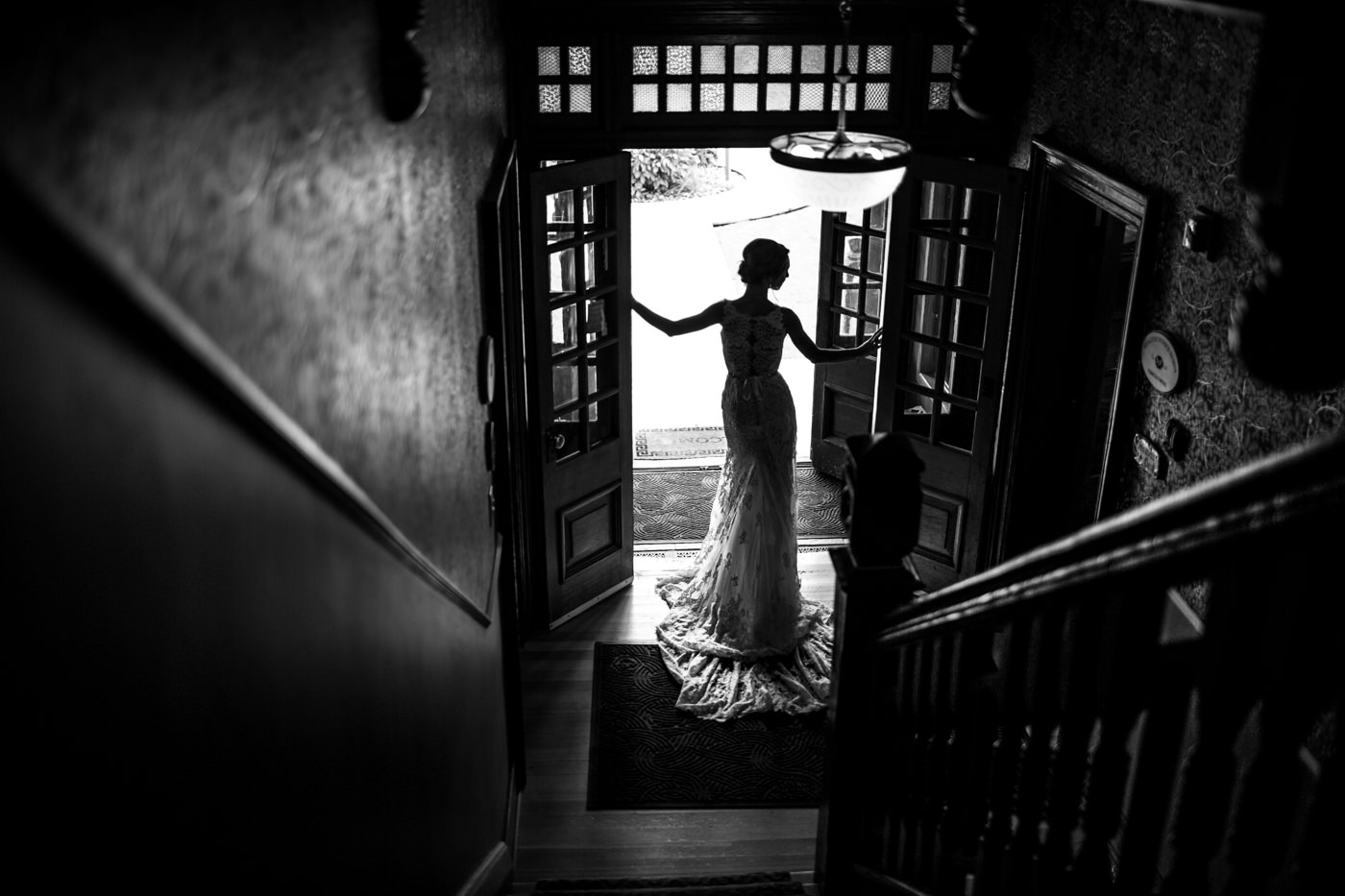Bride poses for wedding photo of her dress in the Bow Valley Ranche Restaurant