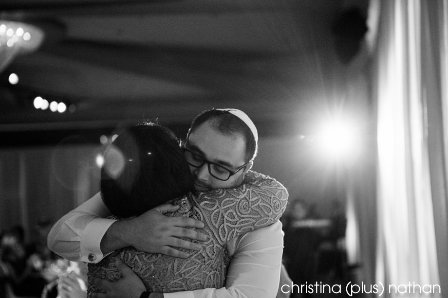 Black and White photo of groom hugging wife