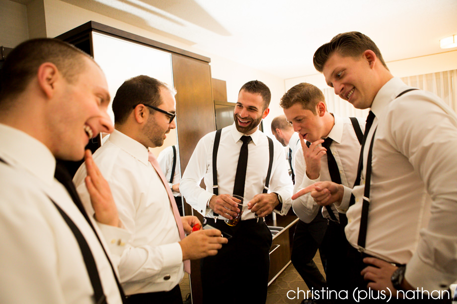 Groomsmen react humourously to seeing the wedding rings for the first time