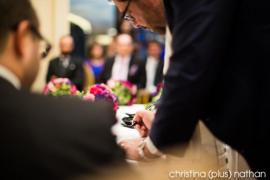 Rabbi signing at Beth Tzedec wedding