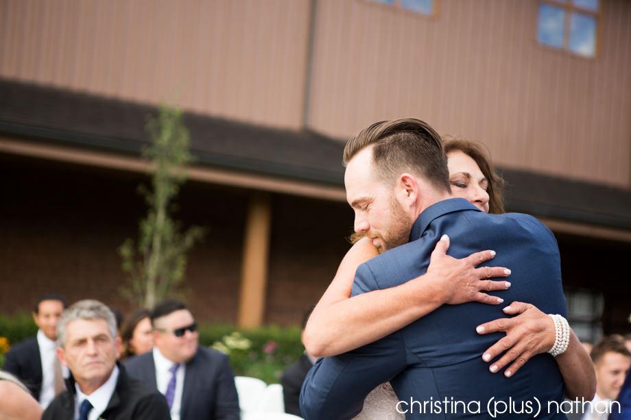 Groom Hugging mom on isle
