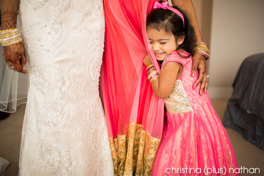 Candid moment with bride and flower girl