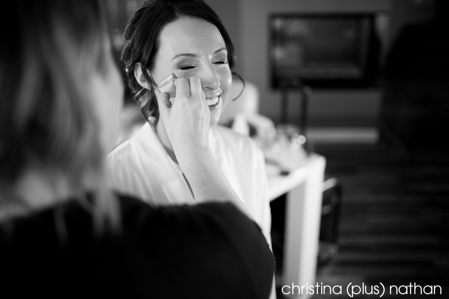 Bride getting make up for wedding