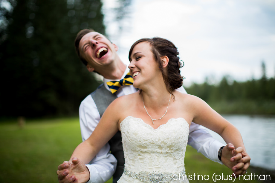 Wedding portraits bride and groom laughing