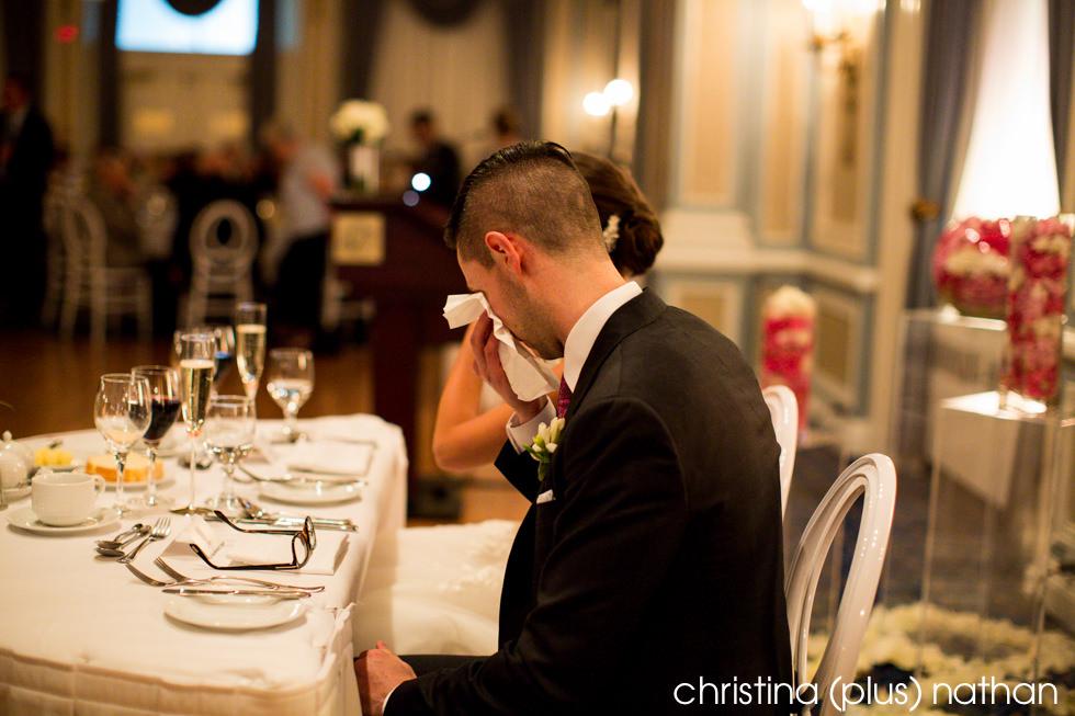 Groom crying at Calgary wedding reception