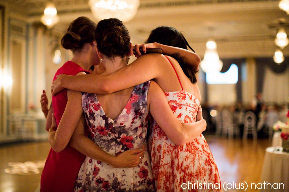 Hug at wedding reception in Calgary