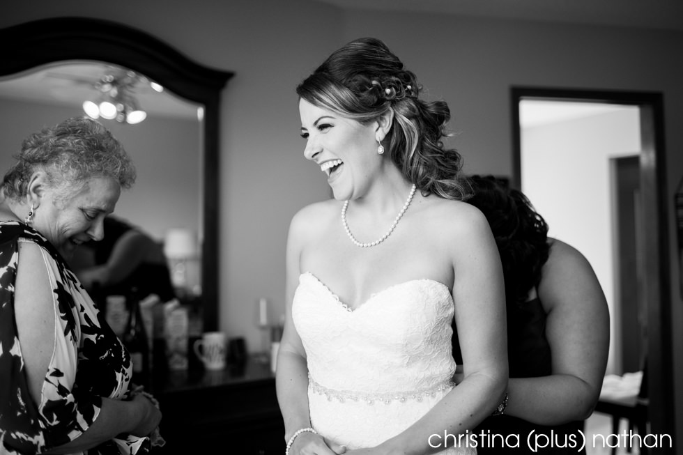Bride laughing before her wedding ceremony at Heritage Park in Calgary