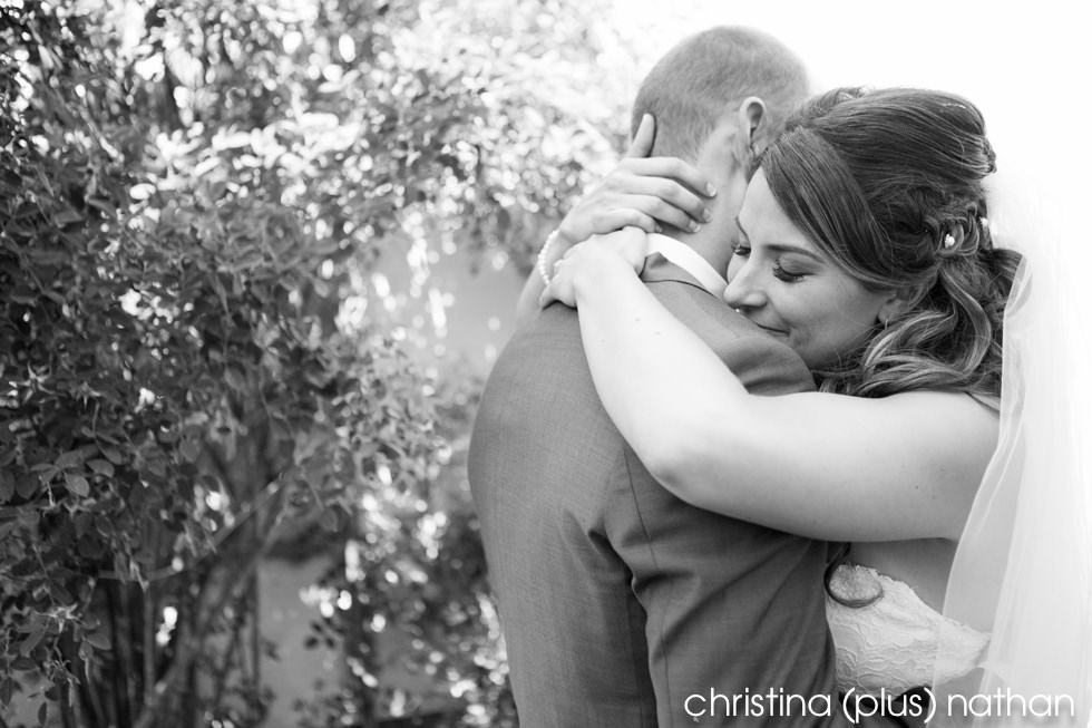Bride and groom embrace at their first look before their Calgary wedding