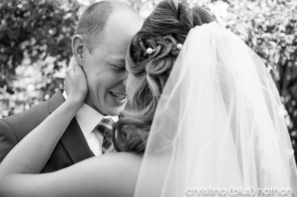 Happy moment at the first look before Heritage Park wedding in Calgary