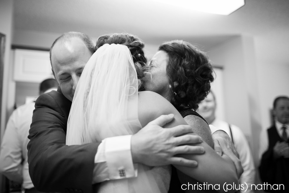 Emotional group hug with bride groom and groom's mother before their Heritage Park wedding