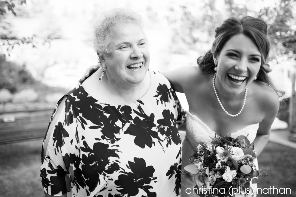 Bride laughs with her mom