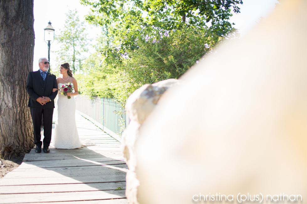 Bride waits to walk down the aisle before her ceremony at Heritage Park