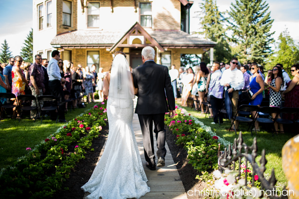 Father walks bride down the aisle at her Heritage Park Calgary wedding