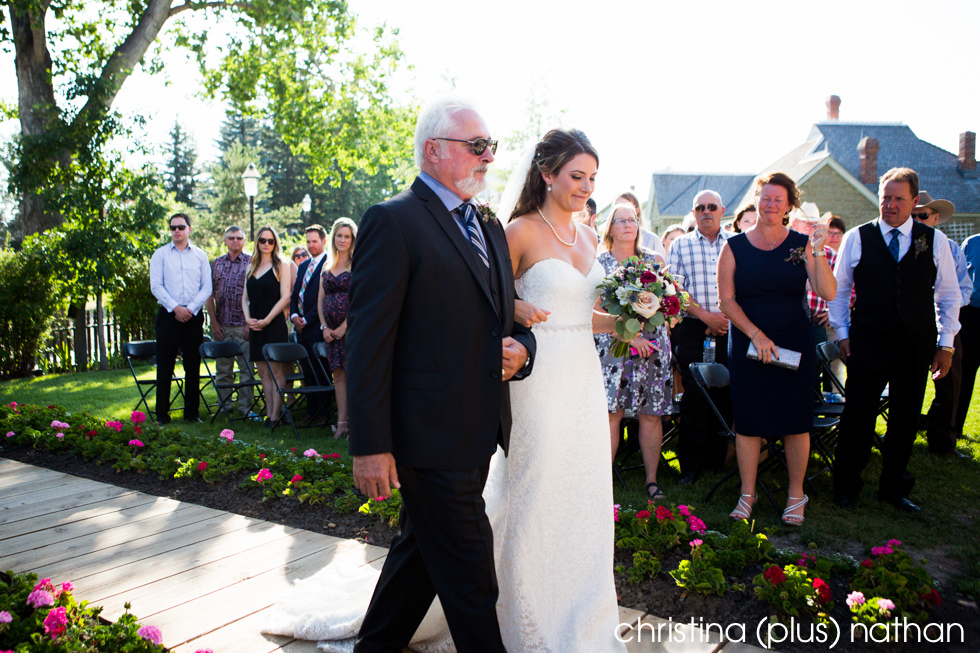 Dad walks his daughter down the aisle at her wedding