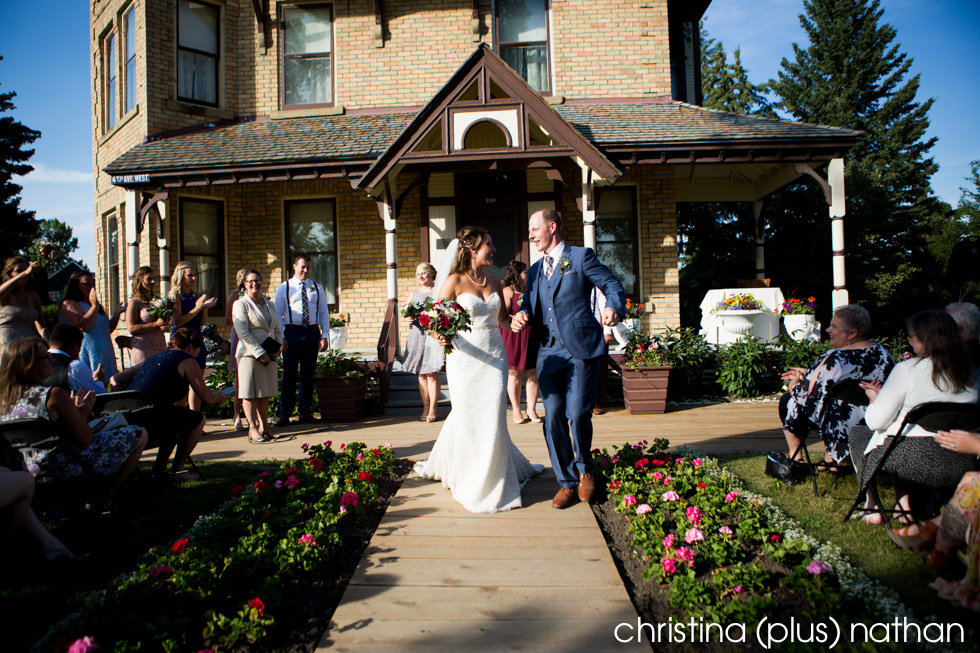Bride and groom dance down the aisle at Heritage Park Prince House