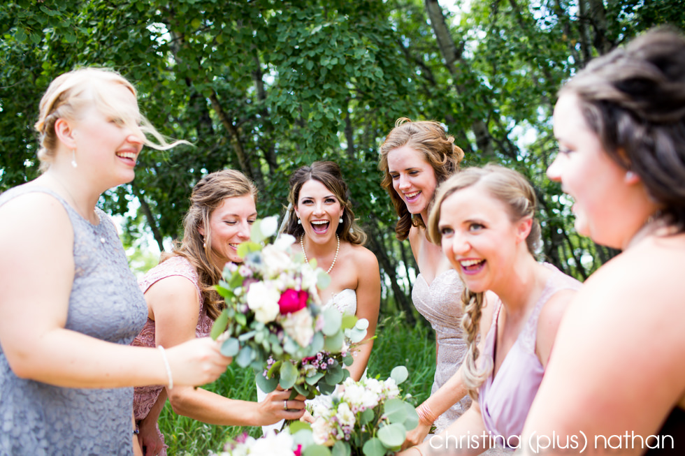 Bride and bridesmaids laughing at her Heritage Park wedding