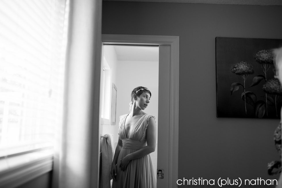 Photograph of bride looking in mirror before wedding starts