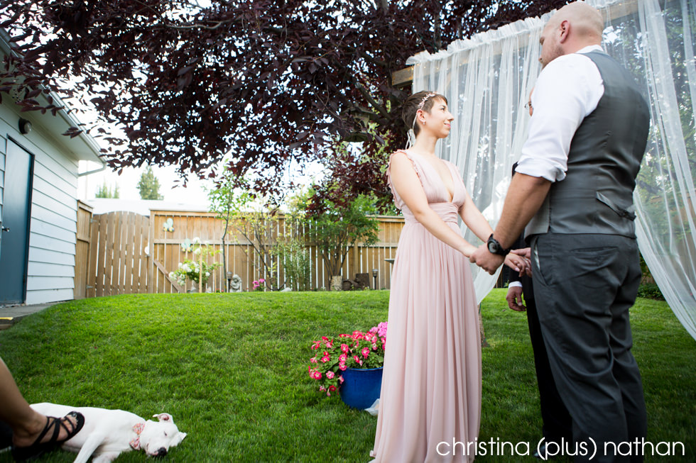 Dog sleeping during wedding ceremony in Calgary Backyard