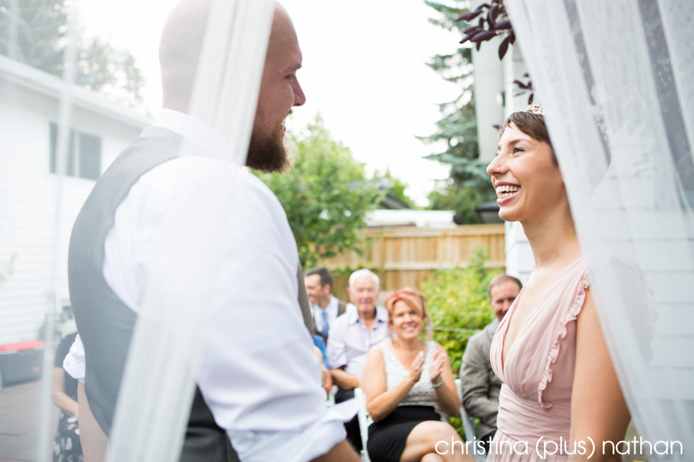 Intimate moment between bride and groom during summer wedding ceremony