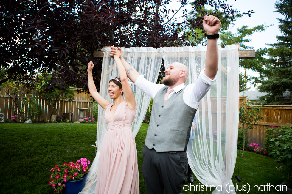 Bride and Groom celebrate after they become husband and wife photographed by Christina plus Nathan