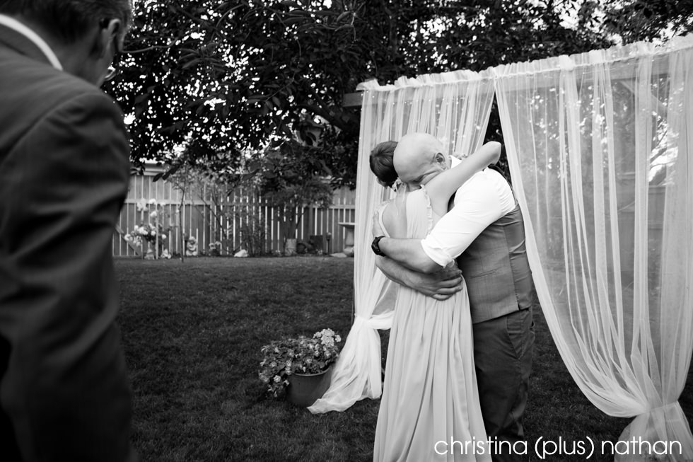 Black and White photography of sharing a hug the moment bride and groom are married