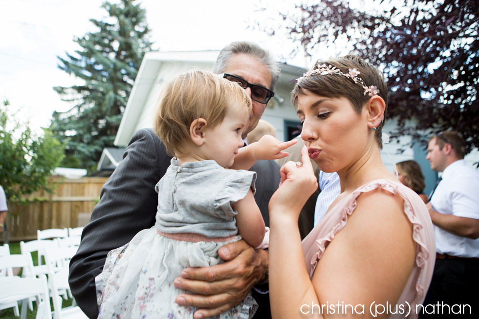 Candid moment with bride and flower girl after the wedding ceremony