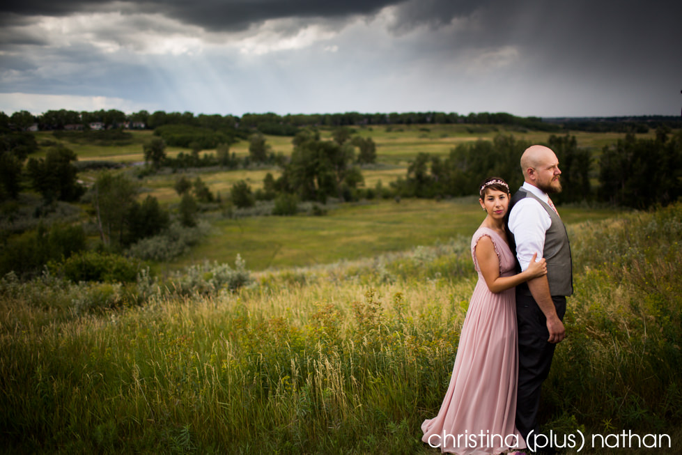 Vintage looking pink wedding dress overlooking Fishcreek Park in Calgary