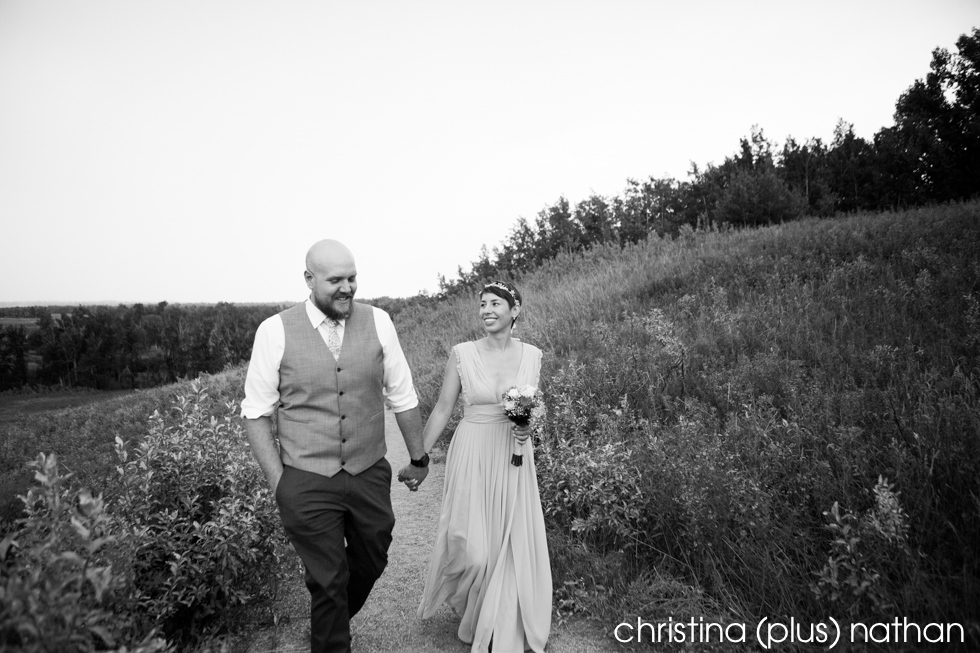 Black and White photography of Bride and Groom happily walking