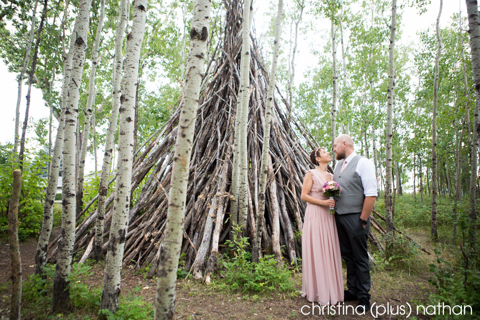 Unique wedding photography location with a teepee and pink wedding dress