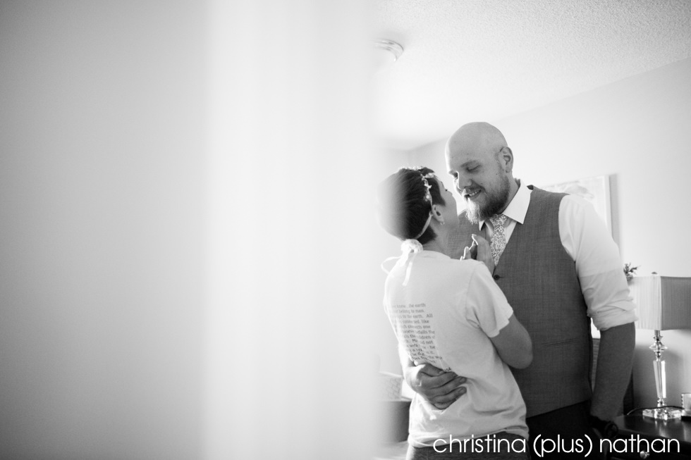 Black and White Photography of Bride and groom sneaking a kiss before wedding
