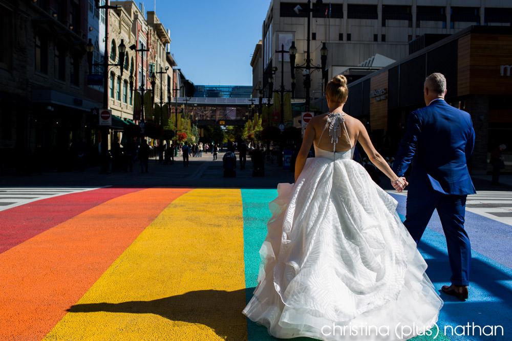 Bride and groom walk down Stephen Avenue in Calgary