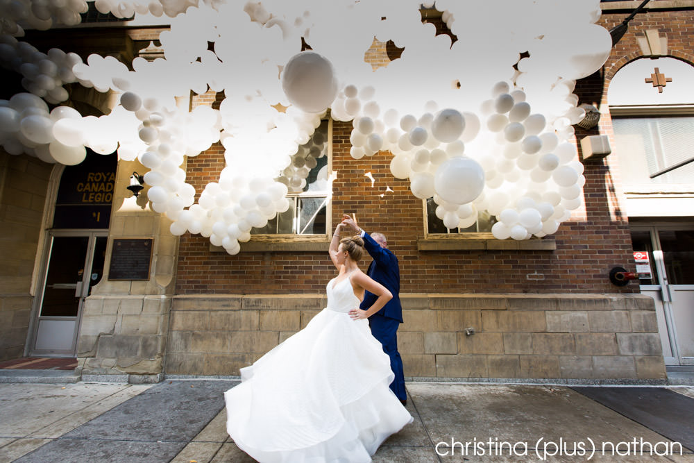 Wedding photo with Beakerhead Nucleation balloons in downtown Calgary