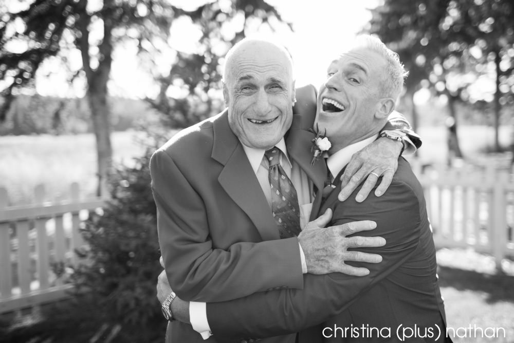 Father embraces son before his Calgary Bow Valley Ranche wedding