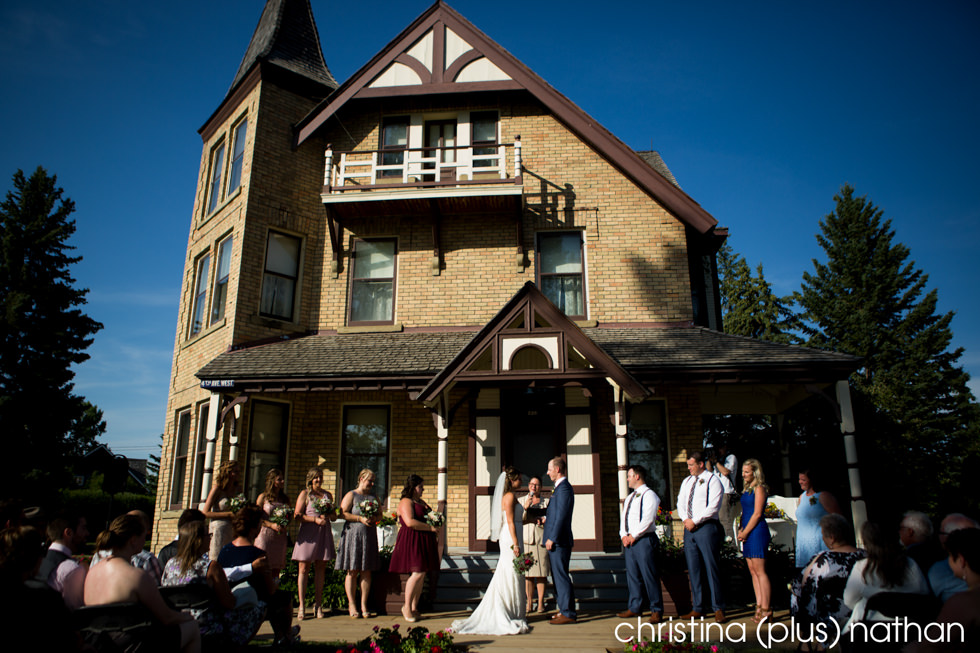 Outdoor Calgary wedding ceremony at Heritage Park's Prince House as photographed by christina (plus) nathan photography