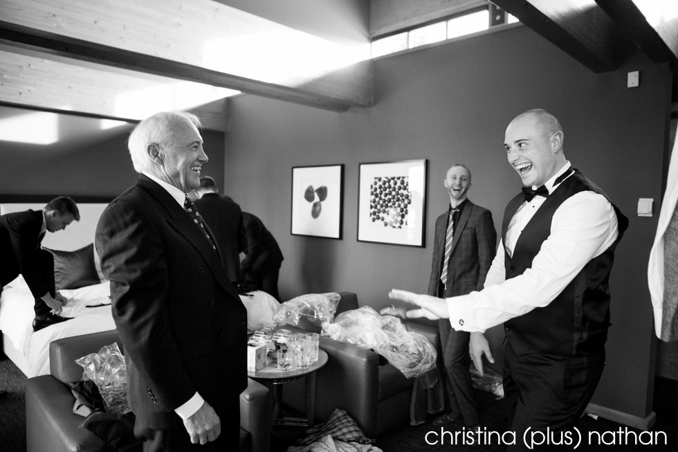 Groom shares a laugh with his dad at his Azuridge Estate Hotel winter wedding