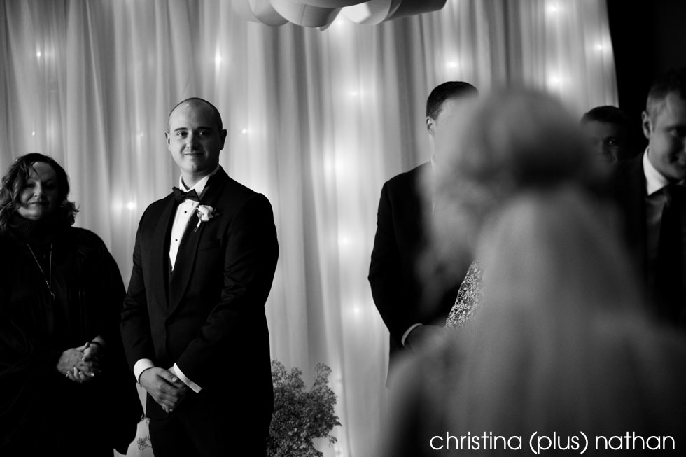 Groom watches as his bride walks down the aisle at Azuridge