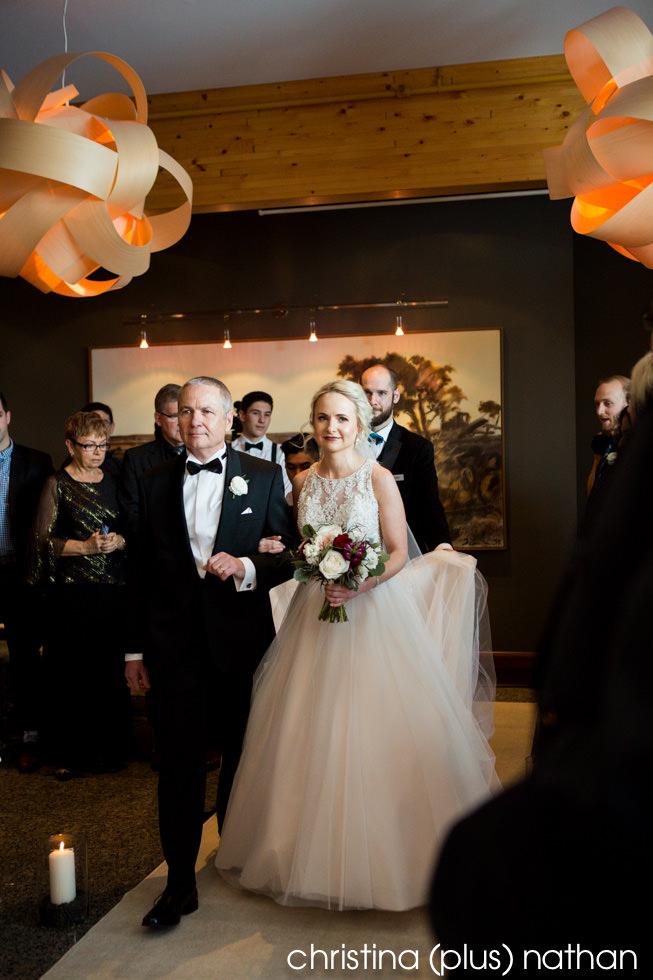 Bride walks down the aisle at her Azuridge indoor wedding ceremony
