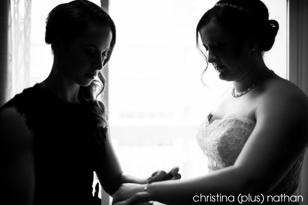 Bride getting ready for wedding in Calgary at hotel arts