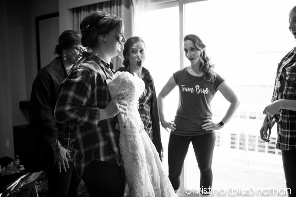 Bride getting ready at Hotel Arts Calgary for her Lake House winter wedding