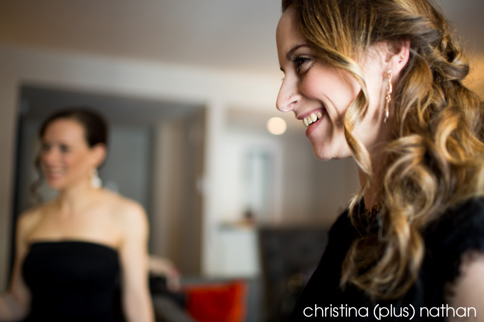 candid photography of happy bridesmaid looking at bride