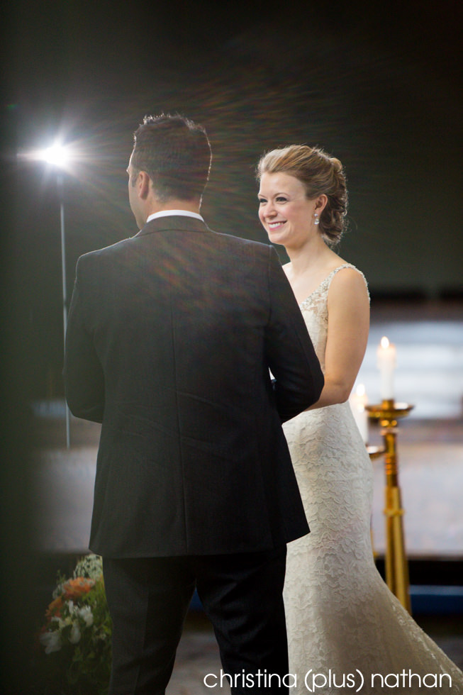 Bride smiles at her groom at their St. Mary's Cathedral wedding