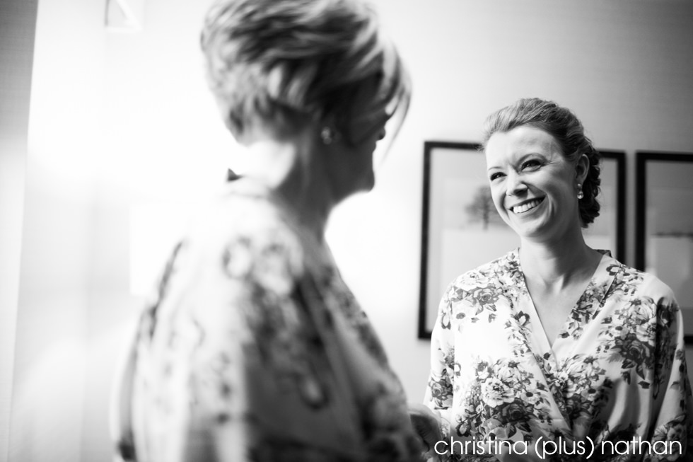 Bride smiles at her mom during her wedding day preparation