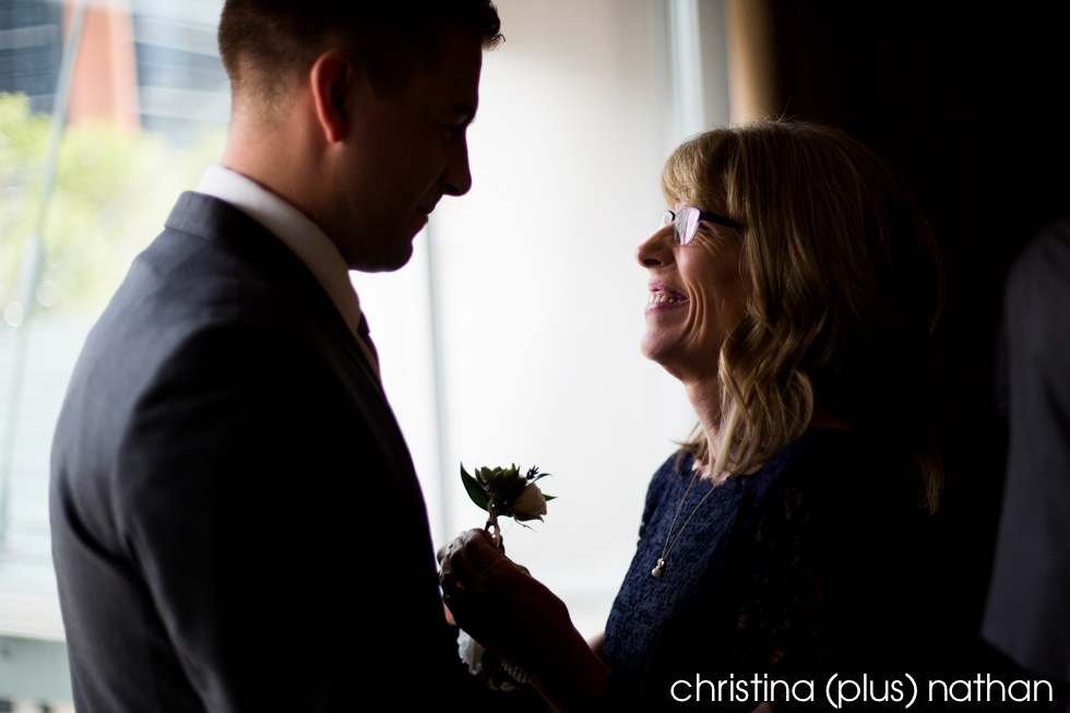 Mom helps with son's boutonniere at his wedding